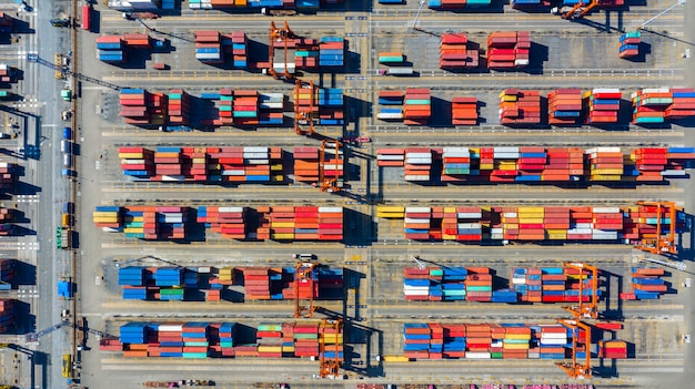 Aerial view shipping container terminal, aerial view containers in the industrial port with lot's of different colors.