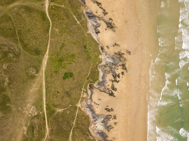 Aerial view of the shore of the ocean near newquay beach, cornwall