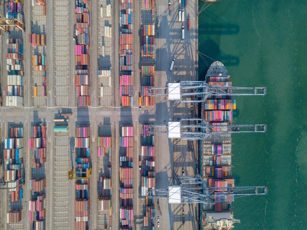Aerial view shot of commercial port export and import goods and thousands of containers in harbor