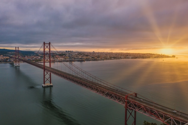 Aerial view shot of a suspension bridge in portugal during a beautiful sunset