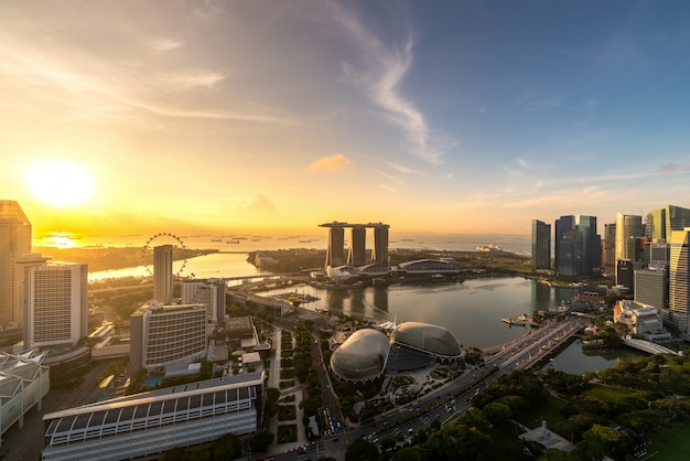 Aerial view of singapore business district and city during sunrise in singapore, asia.