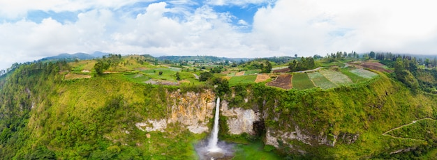 Aerial view sipiso-piso waterfall in sumatra, indonesia.