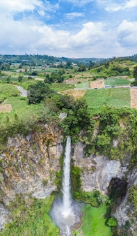 Aerial view sipiso-piso waterfall in sumatra, travel destination in berastagi, indonesia