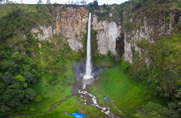 Aerial view sipiso-piso waterfall in sumatra, travel destination in berastagi and lake toba, indonesia