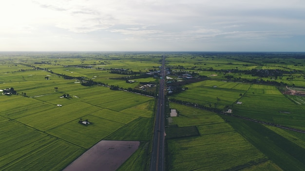 Aerial view over small village, country roadside.