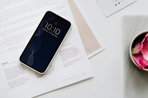 Aerial view of smartphone on table workplace