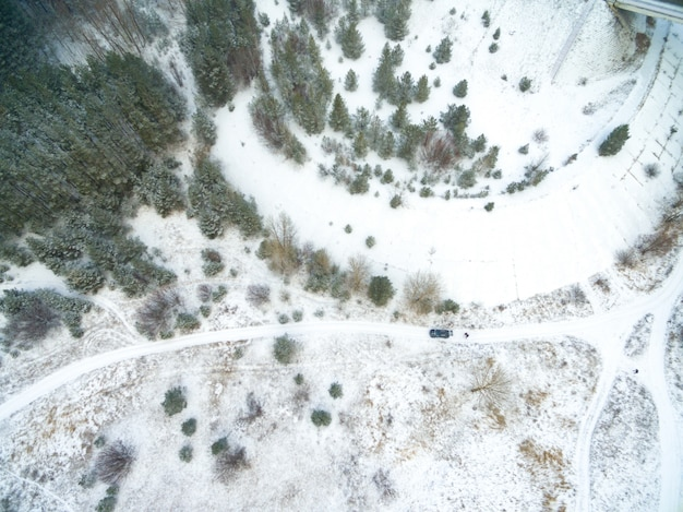 Aerial view of snow covered countryside