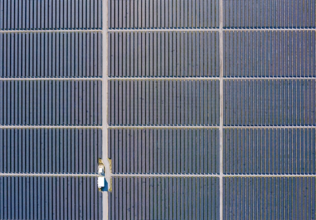 Aerial over view solar cells area factory farm in thailand