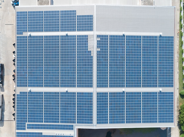 Aerial view of solar panel on factory rooftop
