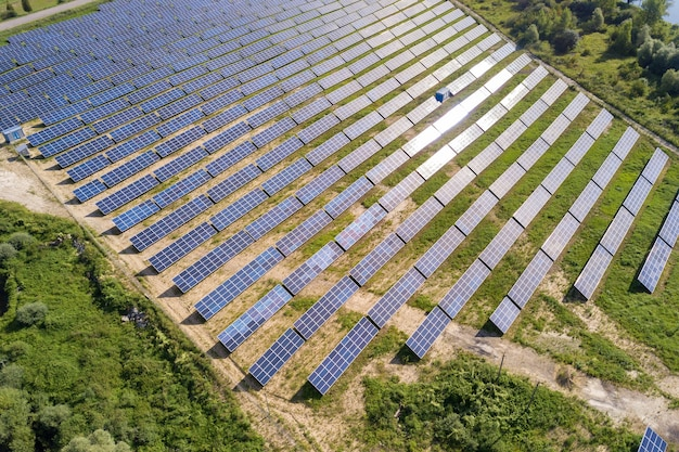 Aerial view of solar power plant on green field.