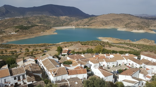 Aerial view of the spanish town with lake  in the background