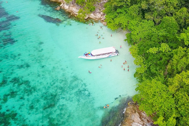 Aerial view over speed boat with beautiful sea and beach