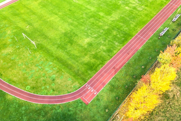 Aerial view of sports stadium with red running tracks