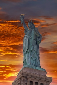 Aerial view statue of liberty the at sunset in new york city, usa.
