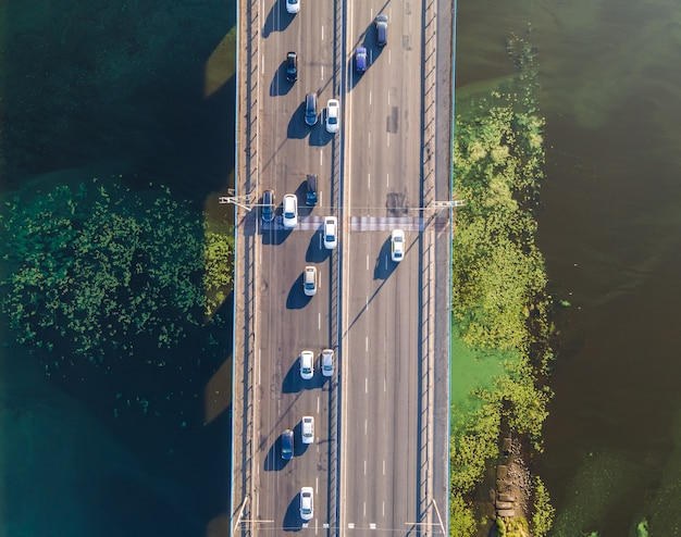 Aerial view of the stream of cars on the bridge