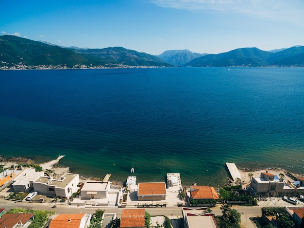 Aerial view of a street with houses on the coast of kotor bay in montenegro