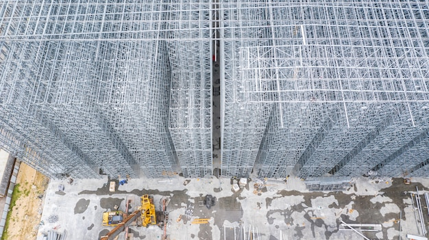 Aerial view structure of steel building construction, metal steel frame buildings construction design, aerial view construction site.