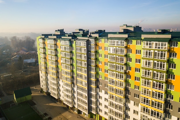 Aerial view of a tall residential apartment building with many windows and balconies.