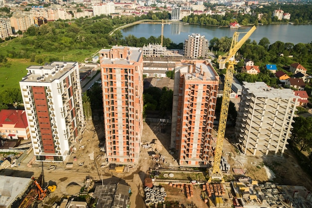 Aerial view of tall residential apartment buildings under construction. real estate development.