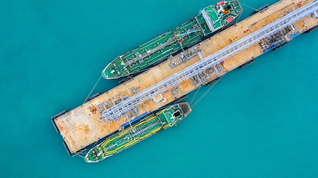 Aerial view tanker ship unloading at port, business import export oil with tanker ship.