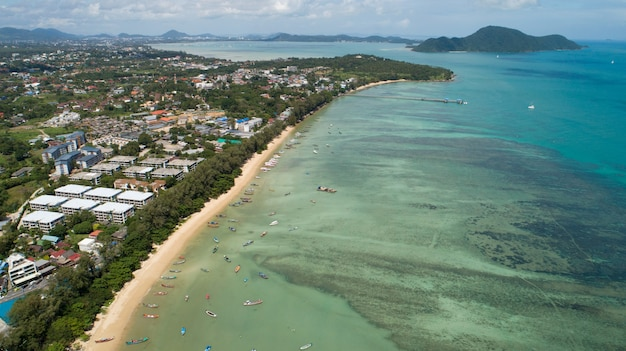Aerial view of thai traditional longtail fishing boats in the tropical sea beautiful beach in phuket thailand.