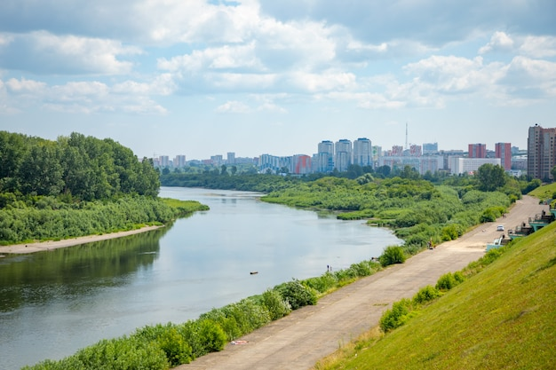 Aerial view of tom river, embankment and cityscape kemerovo city, siberia, russia