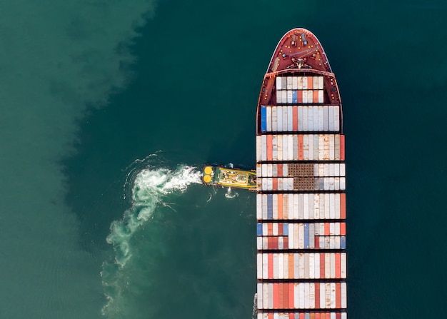 Aerial view or top view of cargo ship, cargo container in warehouse harbor