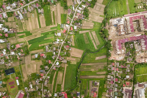 Aerial view of town or village with rows of buildings