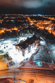 Aerial view of town in winter at night