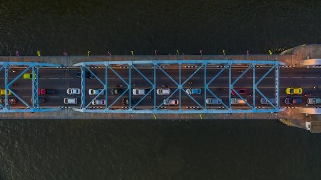 Aerial view on traffic bridge over river, cars on bridge
