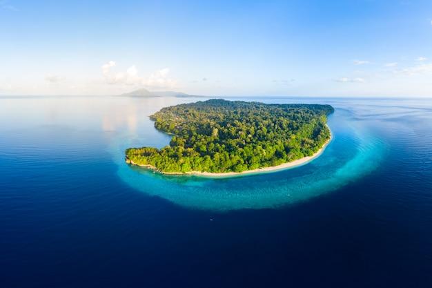 Aerial view tropical beach island reef caribbean sea. indonesia moluccas archipelago