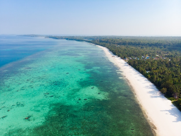 Aerial view tropical beach island reef caribbean sea at pasir panjang. indonesia moluccas archipelago, kei islands, banda sea. top travel destination, best diving snorkeling, stunning panorama.