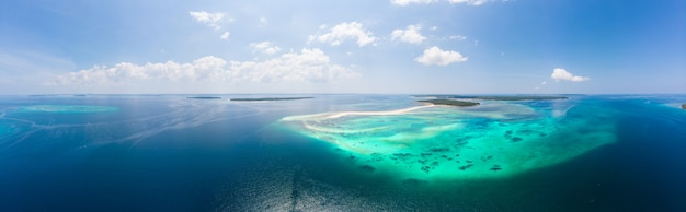 Aerial view tropical beach island reef caribbean sea. white sand bar snake island, indonesia moluccas archipelago, kei islands