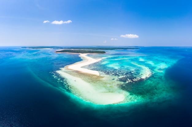 Aerial view tropical beach island reef caribbean sea. white sand bar snake island, indonesia