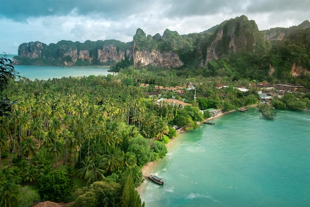 Aerial view of tropical island, blue lagoon, rocks and palms