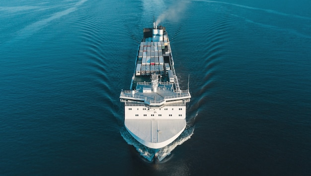 Aerial view of vehicles carrier in the sea