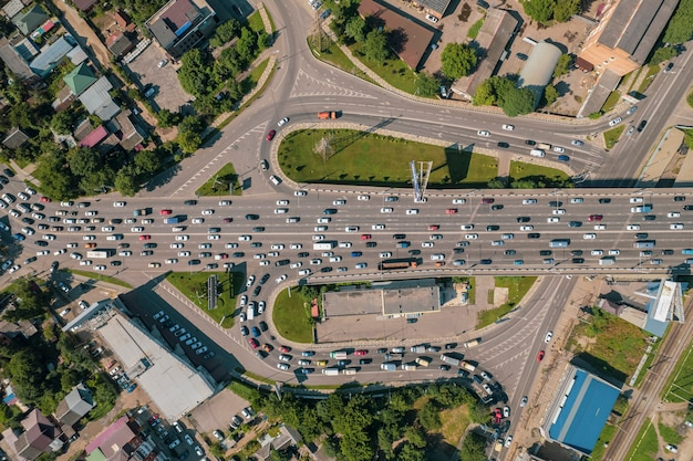 Aerial view of the vehicular intersection traffic at peak hour with cars on the road