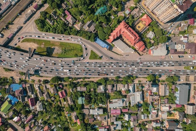 Aerial view of the vehicular intersection traffic at peak hour with cars