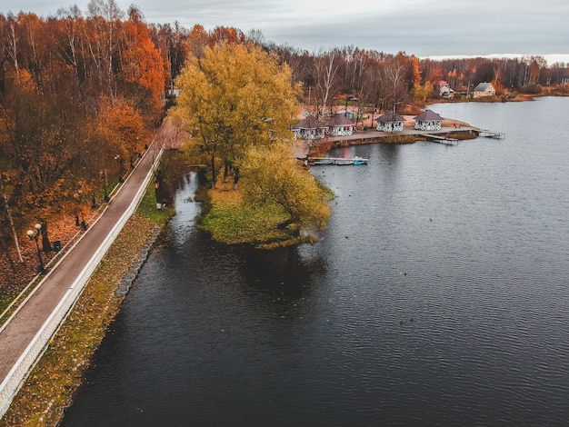 Aerial view walking path along the lake, colorful autumn forest. st. petersburg, russia.