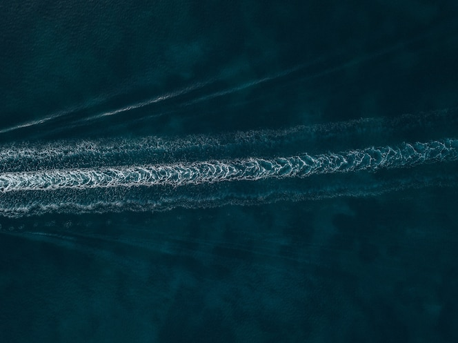 Aerial view of water trails on the blue beautiful sea
