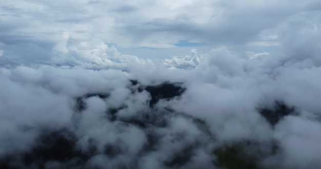 Aerial view white clouds. view from drone. aerial view cloudscape. view from above. sunrise or sunset over clouds.