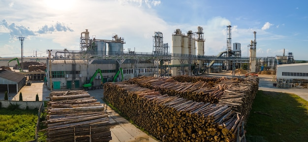 Aerial view of wood processing factory with stacks of lumber at plant manufacturing yard.