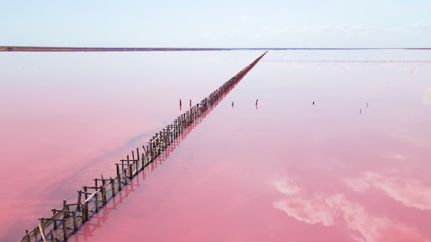 Aerial view of wooden structures for collecting salt on a pink lake, genichesk, ukraine.