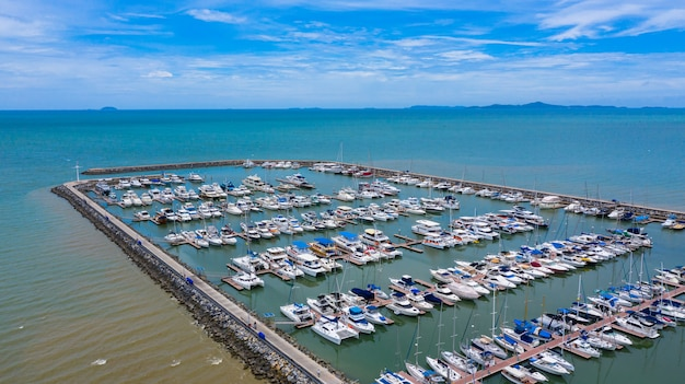 Aerial view of yachts and boat berthed in the marina.