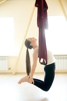 Aerial yoga: ustrasana pose