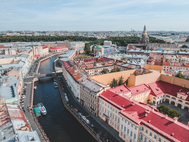 Aerialphoto moika river, city center, old houses, river boats. st. petersburg, russia.