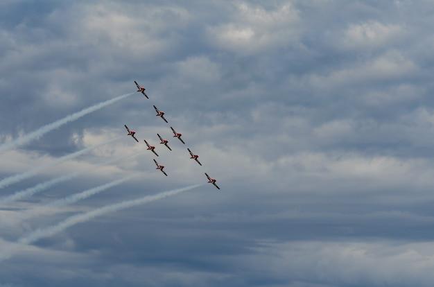 Aerobatic planes performing at air show in swift current, saskatchewan, canada