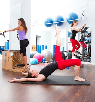 Aerobics pilates gym women group and crosstrainer