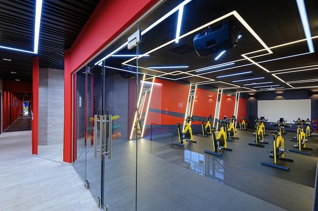 Aerobics spinning indoor bikes gym behind a glass door