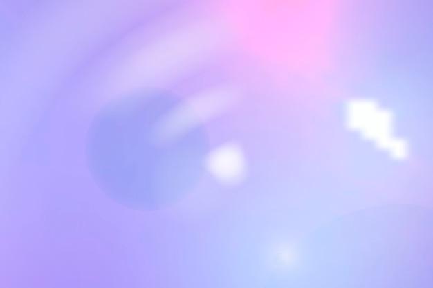 紫色の背景に美的な青いスペクトルレンズフレア